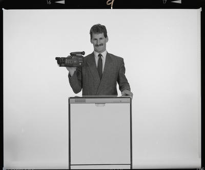 Negative: Man With Video Camera And Dishwasher