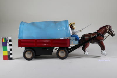 Toy mechanical wagon pulled by horse