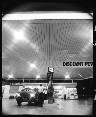 Negative: Man And Car At Service Station