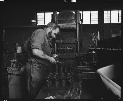 Negative: Man Working In Workshop