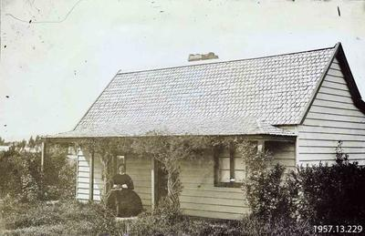 Photograph: Cottage and Woman