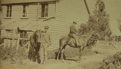 Photograph: Two men with Horses