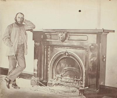 Photograph: Dr Barker by the Fireplace