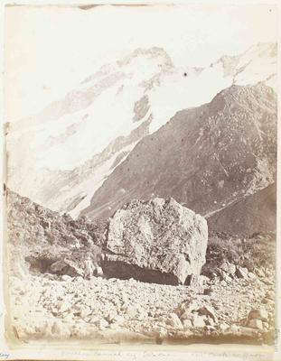Photograph: Man in Hat by Boulder, Mt Cook Region