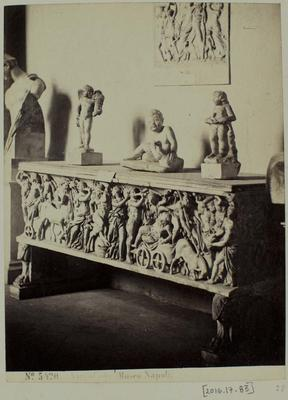 Photograph: Three Sculptures on Carved Table