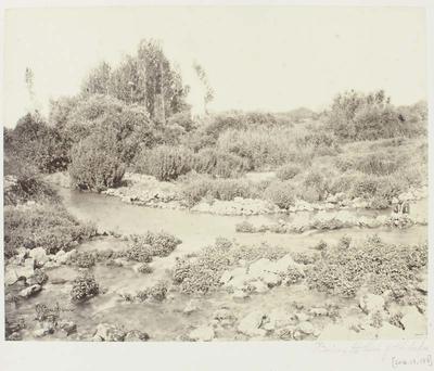 Photograph: Man on Rocks in Waterway