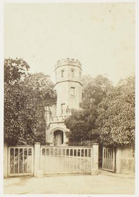 Photograph: Castle Tower Behind Gates, Rugby