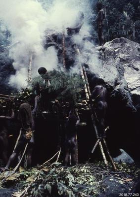 35mm Slide: Dani Man Stoking a Fire