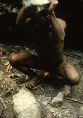35mm Slide: Dani Man Hammering Epidote Rock