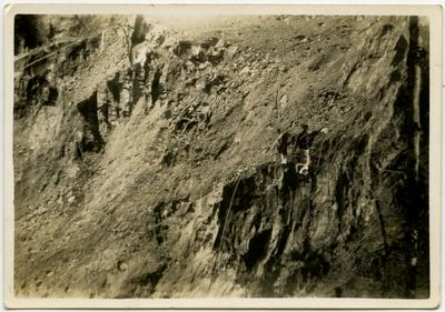 Photograph: Men working on steep face on Lewis Pass Road.; 1930s; 2018.13.5