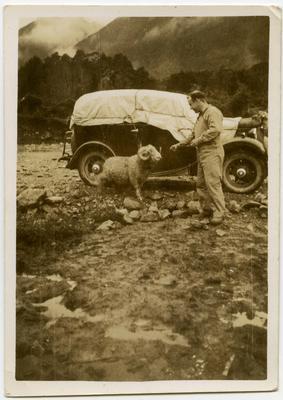 Photograph: Man with pet ram, Lewis Pass