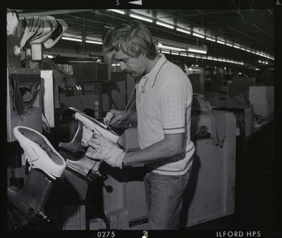 Negative: Man Making Shoes