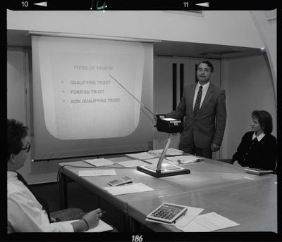 Negative: Man Presenting At Meeting