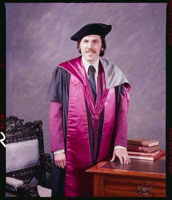 Negative: Mr Moore Graduate