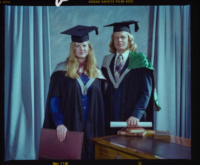 Negative: Mr C. Holmes and Miss Murray Graduates