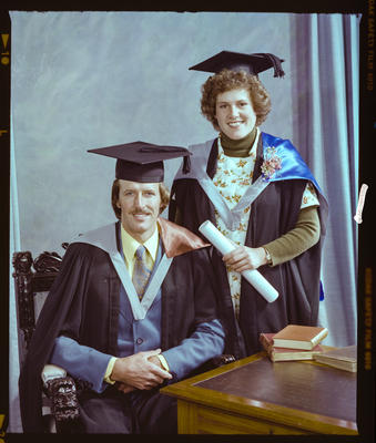 Negative: Miss Wensly and Unnamed Man Graduates