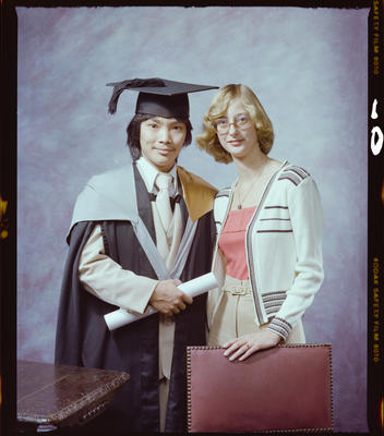 Negative: Mr T. F. Phan Graduate and Unnamed Woman