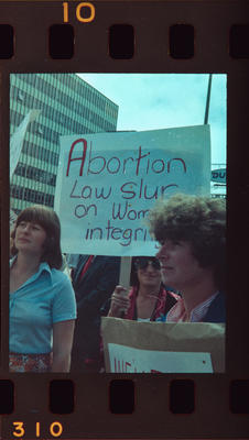 Negative: Women Protesting With Signs
