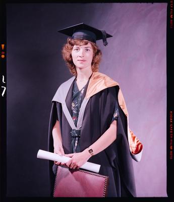 Negative: Mrs Tompkins Graduate