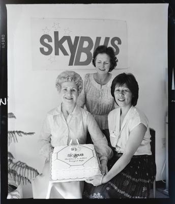 Negative: Three Women and Sky Bus Cake