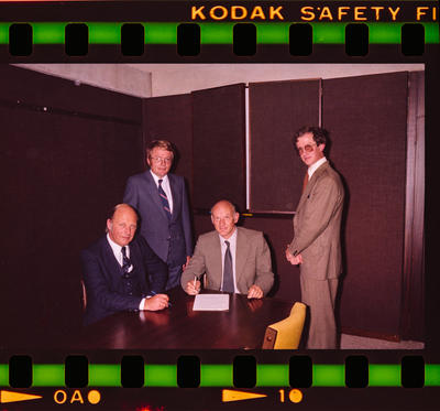 Negative: Four Men Signing A Contract