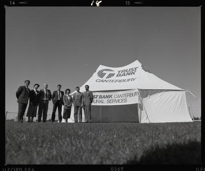 Negative: Seven Trust Bank Staff With Tent