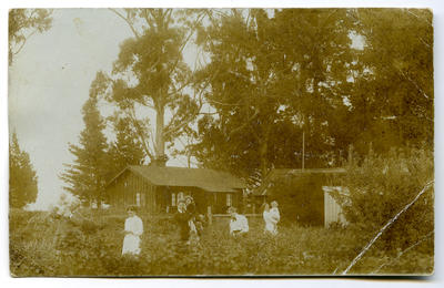 Postcard: Lovell-Smith family group in back garden at Westcote 1912