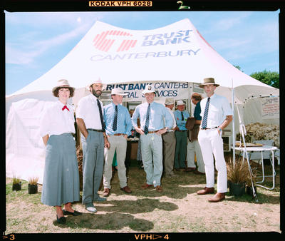 Negative: Trust Bank Staff Outside Tent