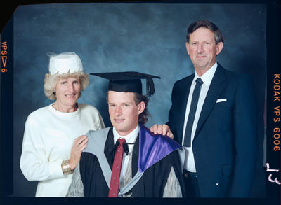 Negative: Unnamed Man Graduate and Family