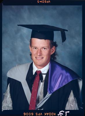 Negative: Unnamed Man Graduate