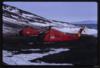 Slide: US Navy helicopters at McMurdo Station; 1968; 2019.91.6