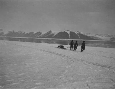 Photograph: Three Men and a Sled