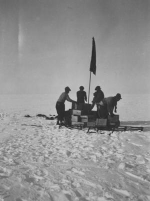 Photograph: Four Men with Supplies
