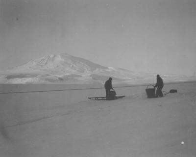 Photograph: Two Men Collecting Ice
