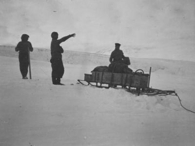 Photograph: Dr Atkinson loading Sledges