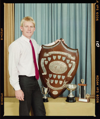 Negative: Pegasus Hockey Man With Award