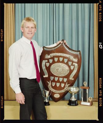 Negative: Pegasus Hockey Man With Award