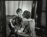 Film Negative: Lady applying lipstick