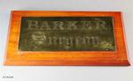 Nameplate: One rectangular shaped brass nameplate mounted on a wooden base.