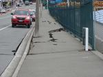 Digital Photograph: Earthquake Damage to Road on Norwich Quay, Lyttelton