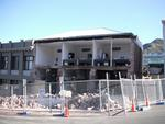 Digital Photograph: Earthquake Damage to Canterbury Hotel and shops. Oxford Street, Lyttelton