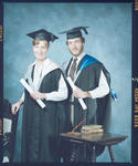 Negative: Mr Rickerby and Unnamed Woman Graduates