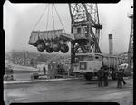 "Film negative: International Harvester Company: payhauler truck. Unloaded by the floating crane ""Rapaki"" at Lyttelton."