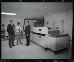 Negative: Three Men With Printing Machine