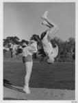 Photograph: Maureen Shaw and Mariette Dixon Performing a Somersault Throw